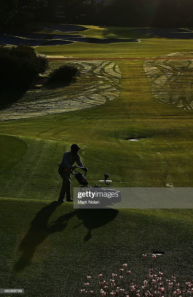 Ground staff prepare the fairways before start of play on day one of the 2013 Australian Open at Royal Sydney Golf Club on November 28, 2013 in Sydney, Australia.
