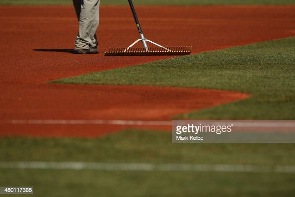 Ground staff prepare the pitch during the MLB match between the Los Angeles Dodgers and the Arizona Diamondbacks at Sydney Cricket Ground on March 23...
