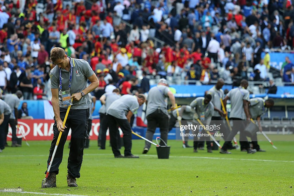Ground staff repair the pitch at half time during the UEFA Euro 2016 Round of 16 match between Italy and Spain at Stade de France on June 27, 2016 in Paris, France.