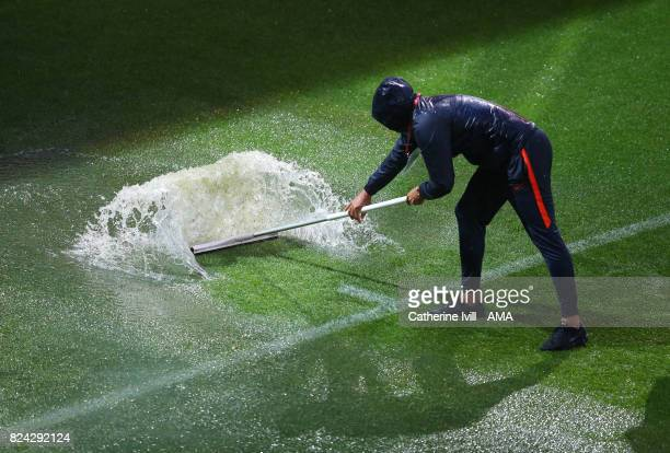 Ground staff sweep water from the pitch before the UEFA Women's Euro 2017 match between Germany and Denmark at Sparta Stadion on July 29 2017 in...
