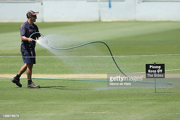 Ground staff water the pitch during a South African Proteas training session at Adelaide Oval on November 19 2012 in Adelaide Australia