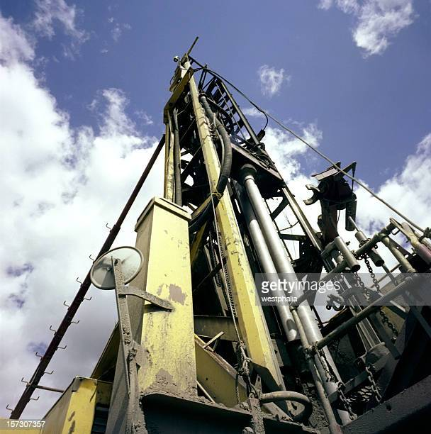 Ground view of a rock drill and the sky