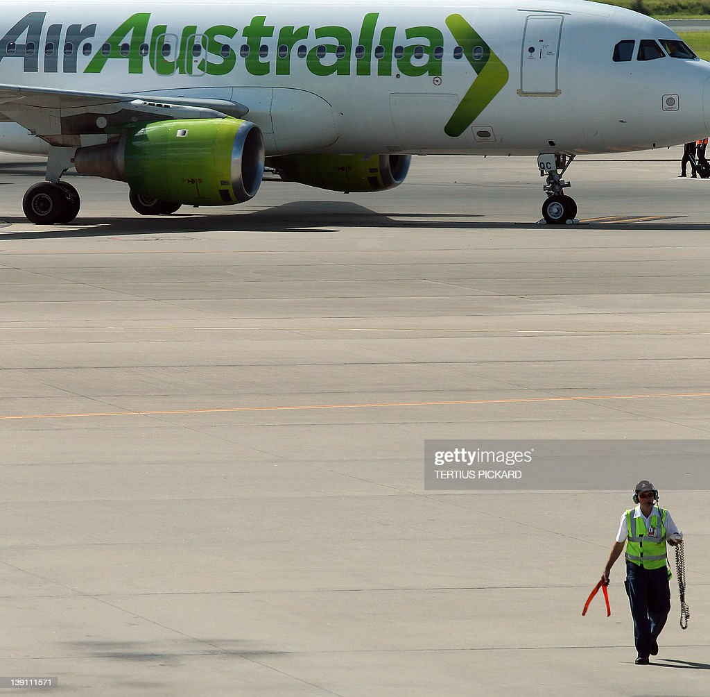 A grounded Air Australia plane sits unattended on the tarmac of the Brisbane International airport in Brisbane on February 17, 2012. Thousands of Air Australia passengers are stranded worldwide after the budget airline was abruptly placed into administration overnight. AFP PHOTO / Tertius PICKARD