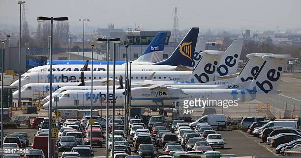 Grounded aircraft sit on the tarmac at the Belfast City airport in Northern Ireland on April 15 following the closure of the airport due to a cloud...
