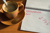 Groundhog day February Notepad with the date of 2 Feb and Cup of espresso.