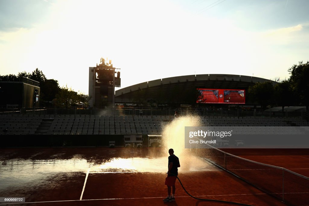 Groundman water the courts on day four of the 2017 French Open at Roland Garros on May 31, 2017 in Paris, France.