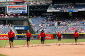 Grounds crew drag the field during the game between the Philadelphia Phillies and Atlanta Braves at Turner Field on June 18 2014 in Atlanta Georgia