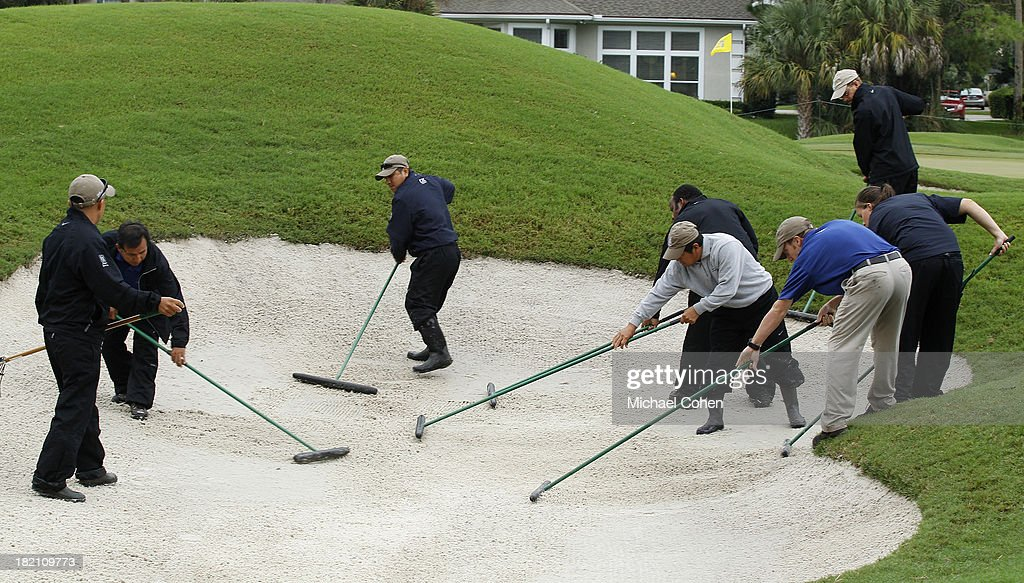 A grounds crew is seen is seen repairing a bunker during a weather suspension of the third round of the Web.com Tour Championship held on the Dye's Valley Course at TPC Sawgrass on September 28, 2013 in Ponte Vedra Beach, Florida.