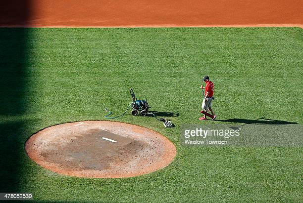 A grounds crew member works on the mound after the game between the Boston Red Sox and the Toronto Blue Jays at Fenway Park on June 14 2015 in Boston...
