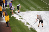 Grounds crew shovel hail off the field prior to the game of the Colorado Rockies v the Toronto Blue Jays at Coors Field on June 2 2016 in Denver...