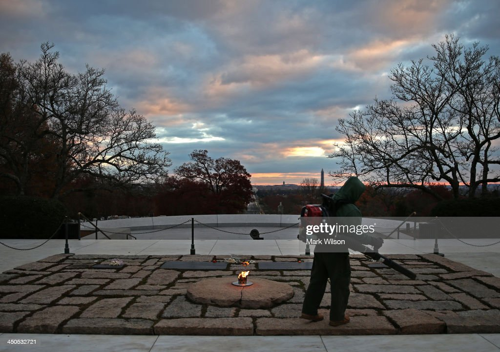 A grounds keeper blows away leaves at the gravesite of the 35th President of the United States John F. Kennedy, at Arlington National Cemetery, on November 19, 2013, in Arlington, Virginia. Friday November 22, 2013 will mark the 50th anniversary of President Kennedy's assassination during his visit to Dallas, Texas, in 1963.