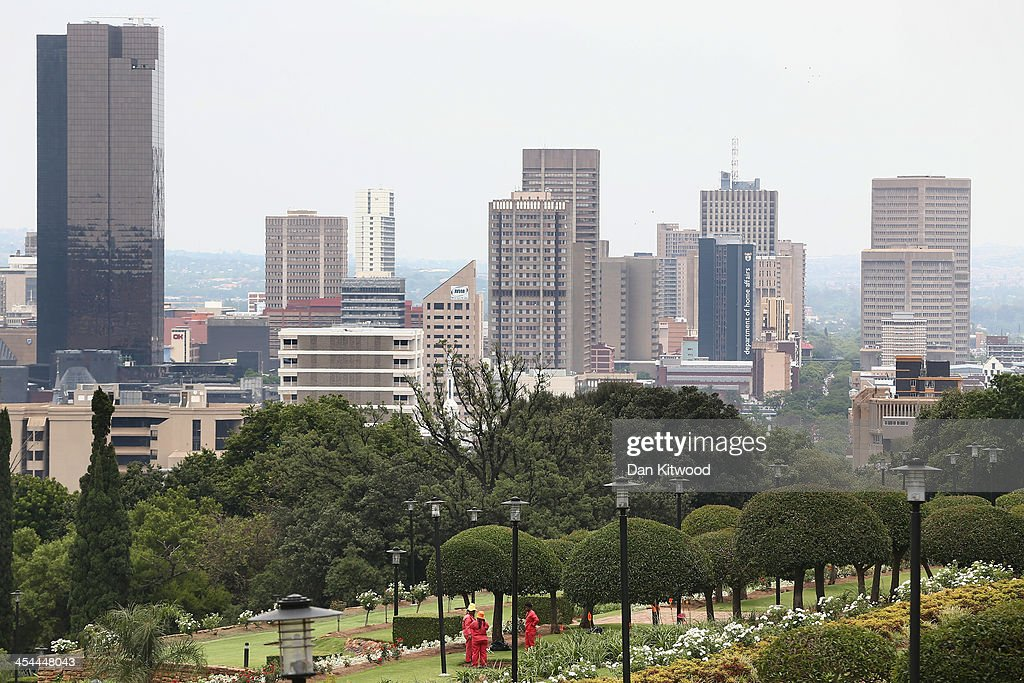 Grounds people work in the gardens at the Union Buildings on December 9 2013 in Pretoria South Africa Final preparations are being made ahead of a...