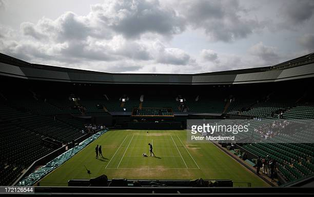 A groundsman paints the white lines on the grass of Centre Court at the Wimbledon Lawn Tennis Championships on July 1 2013 in London England The 2013...