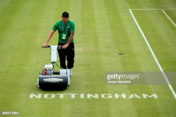 A groundsman prepares the court ahead of the start of play on day two of the Aegon Open Nottingham at Nottingham Tennis Centre on June 13 2017 in...