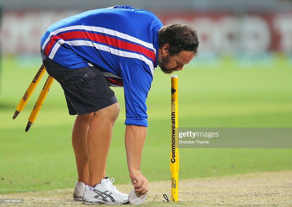 A groundsman removes stumps after play was abandoned due to rain following game four of the Commonwealth Bank one day international series between Australia and Sri Lanka at Sydney Cricket Ground on January 20, 2013 in Sydney, Australia.