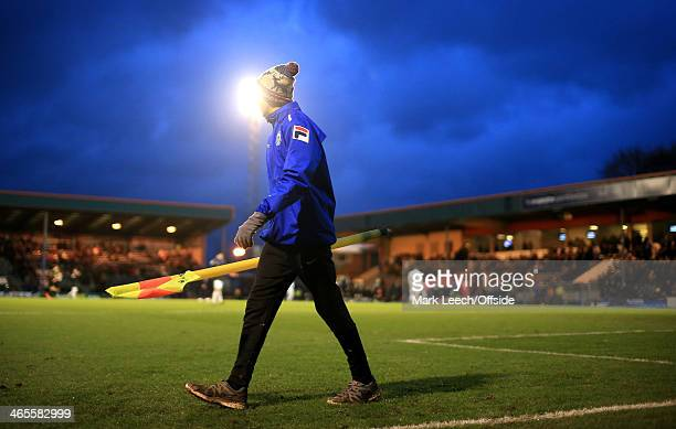 A groundsman removes the corner flag after the FA Cup with Budweiser Fourth Round match between Rochdale and Sheffield Wednesday at Spotland on...