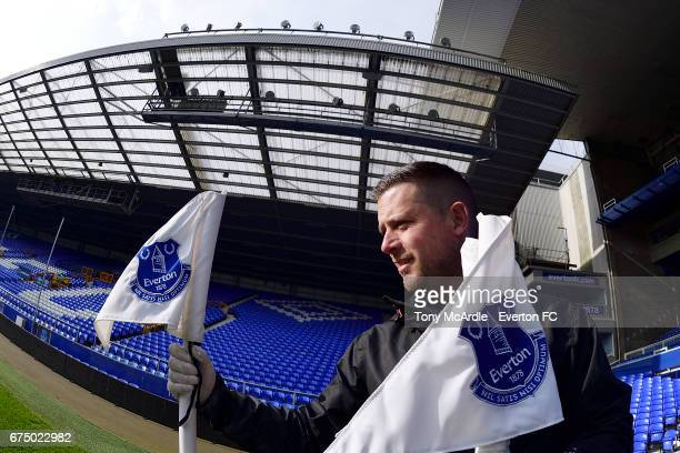 Groundsman Tony Sage places the corner flags Goodison Park before the Premier League match between Everton and Chelsea at the Goodison Park on April...