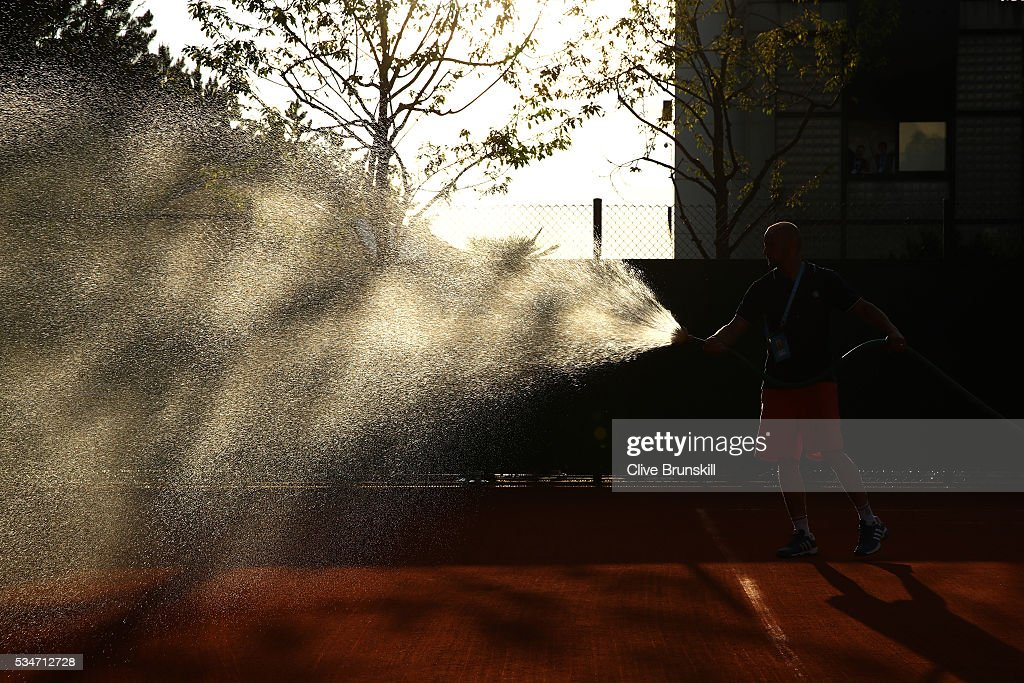 A groundsman waters court ten after the days play on day six of the 2016 French Open at Roland Garros on May 27, 2016 in Paris, France.