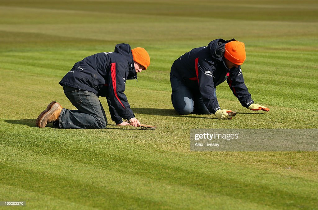 Groundsmen at Lancashire CCC work on the pitch during a pre-season photocall at Old Trafford on April 2, 2013 in Manchester, England.
