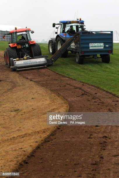 Groundsmen plough up the spectator walkways along the first fairway of the Twenty Ten Course at Celtic Manor
