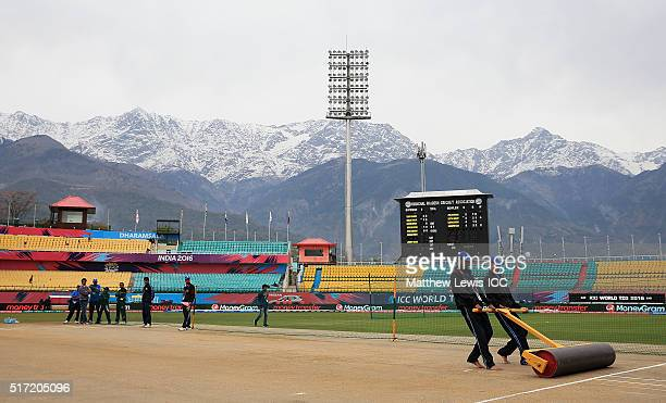 Groundsmen prepare the pitch ahead of the Women's ICC World Twenty20 India 2016 match between England and the West Indies at the HPCA Stadium on...