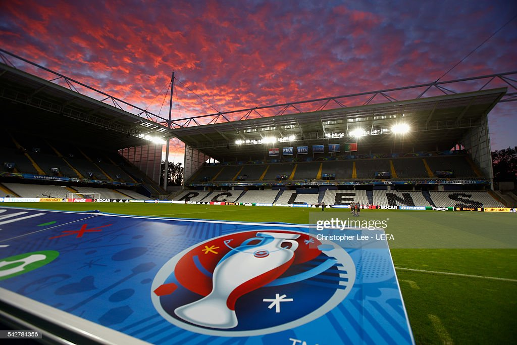 Groundsmen prepare the pitch at the Stade Bollaert-Delelis as the sun sets on June 24, 2016 in Lens, France for the forthcoming the Round of 16 match between Croatia and Portugal at Stade Bollaert-Delelis on June 25, 2016 in Lens, France.