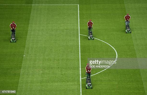 Groundsmen prepare the pitch on the eve of the UEFA Europa League final football match between FC Dnipro Dnipropetrovsk and Sevilla FC at the...