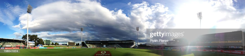 Groundsmen water the pitch after the end of day five of the First Test match between Australia and Sri Lanka at Blundstone Arena on December 18, 2012 in Hobart, Australia.