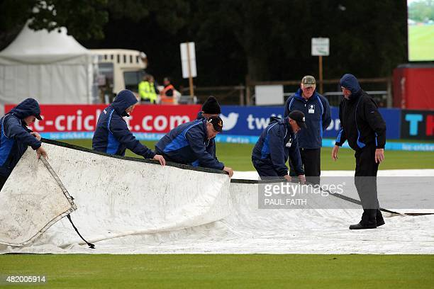 Groundsmen work on the rainsoaked ground ahead of the ICC World Twenty20 3rd Place playoff game between Ireland and Hong Kong at Malahide cricket...