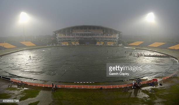 Groundstaff cover the field as rain delays play during the 3rd One Day International between Sri Lanka and England at Mahinda Rajapaksa International...