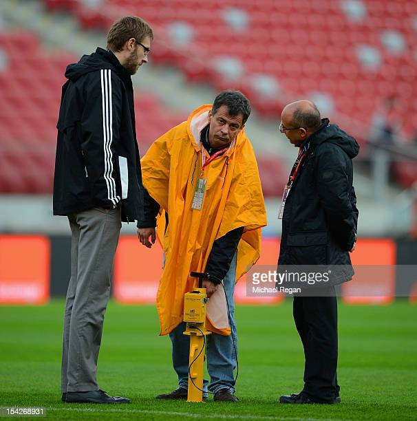 Groundstaff inspect the pitch before the FIFA 2014 World Cup Qualifier between Poland and England at the National Stadium on October 17 2012 in...