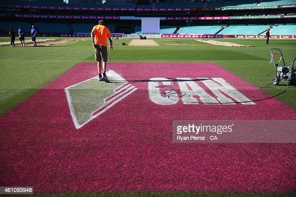 Groundstaff paint logos on the turf during day two of the Fourth Test match between Australia and India at Sydney Cricket Ground on January 7 2015 in...