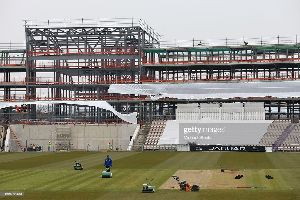 Groundstaff prepare the square as building work on a new stand takes shape during the Hampshire CCC photocall at The Ageus Bowl on April 8, 2013 in Southampton, England.