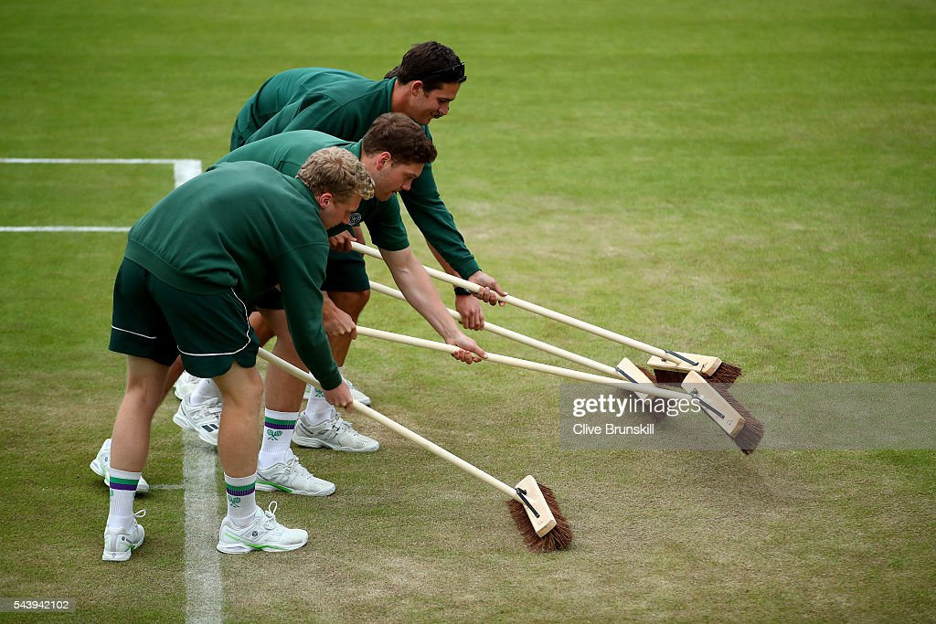 Groundstaff sweep court two following the end of play on day four of the Wimbledon Lawn Tennis Championships at the All England Lawn Tennis and Croquet Club on June 30, 2016 in London, England.