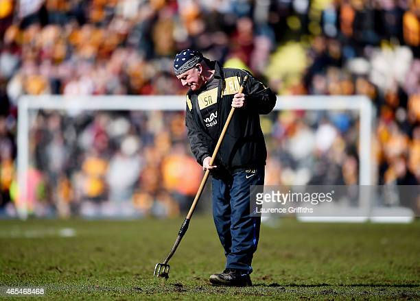 Groundstaff tend to the pitch at halftime during the FA Cup Quarter Final match between Bradford City and Reading at the Coral Windows Stadium Valley...