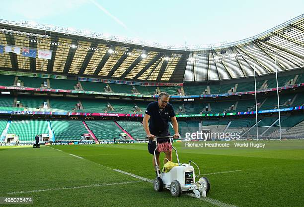 Groundtaff prepare the pitch prior to the 2015 Rugby World Cup Final match between New Zealand and Australia at Twickenham Stadium on October 31 2015...
