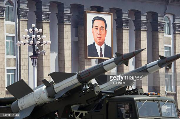 SA3 groundtoair missiles are displayed before a portrait of former North Korean leader Kim IlSung during a military parade to mark 100 years since...
