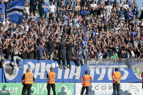 Group 1905 Bastia's supporters cheer for their team during the L1 football match Bastia against Lyon on April 16 2017 in the Armand Cesari stadium in...