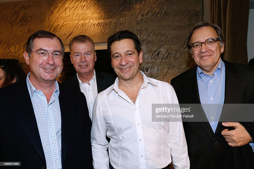 CEO Group Bouygues Martin Bouygues, CEO Samsung France Jacques Mollet, Laurent Gerra and CEO Group TF1 Nonce Paolini pose backstage following the show of impersonator Laurent Gerra 'Un spectacle Normal' at L'Olympia on December 19, 2013 in Paris, France.