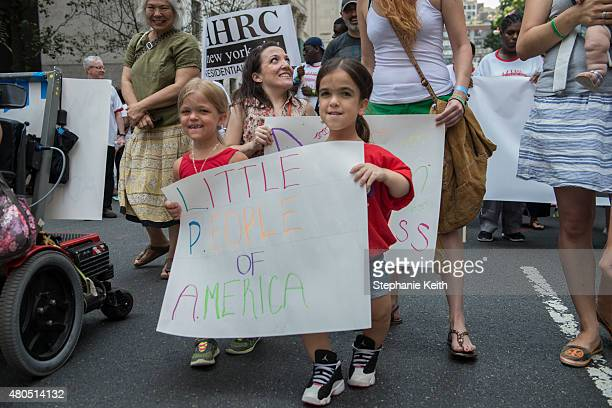 A group called the Little People of America participate in the first annual Disability Pride Parade on July 12 2015 in New York City The parade calls...