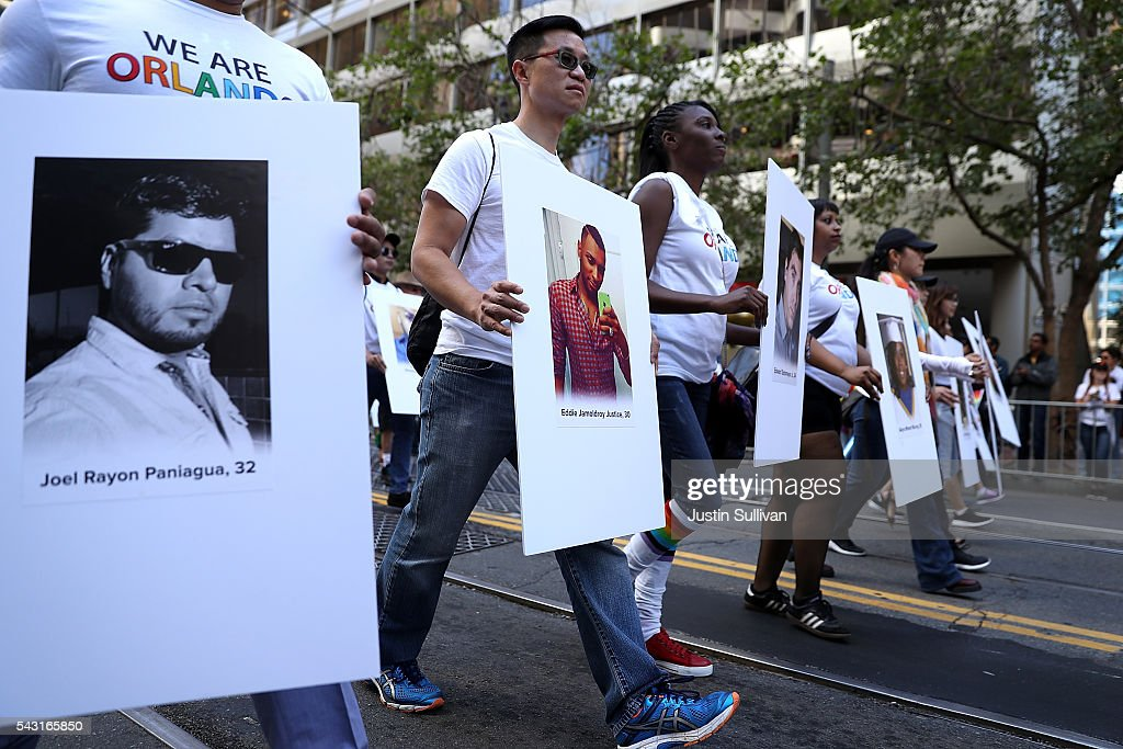 A group carries photos of victims of the Orlando nightclub shooting during the 2016 San Francisco Pride Parade on June 26, 2016 in San Francisco, California. Hundreds of thousands of people came out to watch the annual San Francisco Pride parade, one of the largest in the world.