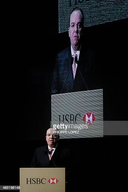 Group CEO Stuart Gulliver delivers a speech prior to the unveiling of a special 150 HKD banknote in Hong Kong on March 4 2015 The bank marked its...