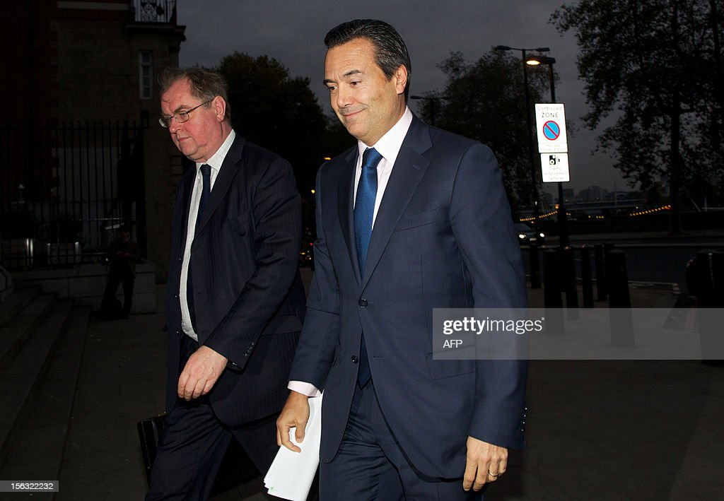 Group Chief Executive of Lloyds Banking Group, Antonio Horta-Osorio, (R) arrives at Portculis House in London, on November 13, 2012, as he prepares to give evidence on Banking Standards to the Parliamentary Commission. AFP PHOTO / ANDREW COWIE