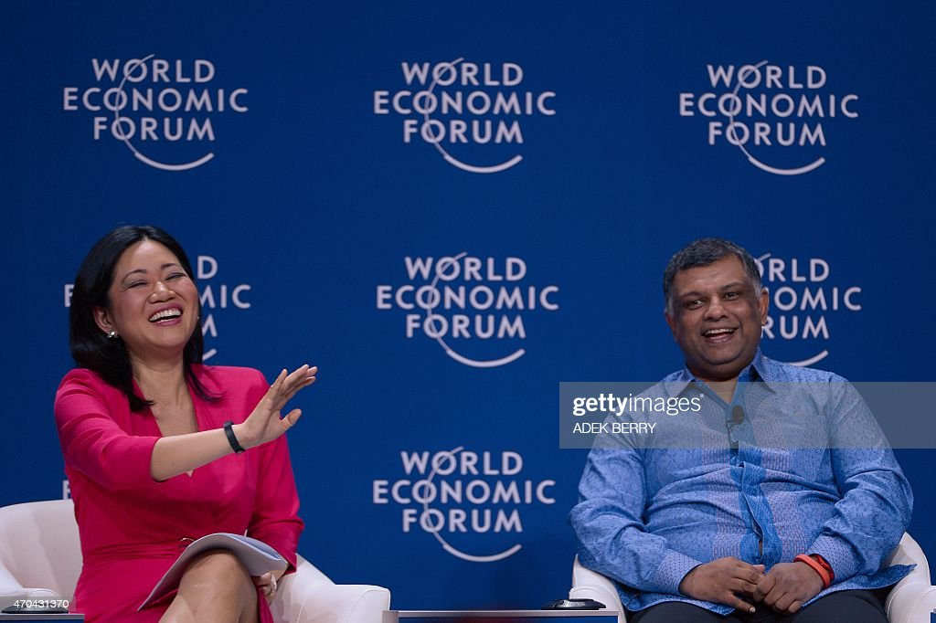Group chief executive officer of AirAsia <a gi-track='captionPersonalityLinkClicked' href=/galleries/search?phrase=Tony+Fernandes&family=editorial&specificpeople=2103805 ng-click='$event.stopPropagation()'>Tony Fernandes</a> (R) smiles next to moderator Linda Yueh prior to a discussion during the World Economic Forum on East Asia in Jakarta on April 20, 2015. Indonesia hosts the World Economic Forum on East Asia, knows as 'Asia's Davos' from 19 to 21 with agriculture, trade and digital infrastructure among the highlights of the three-day program. AFP PHOTO / ADEK BERRY