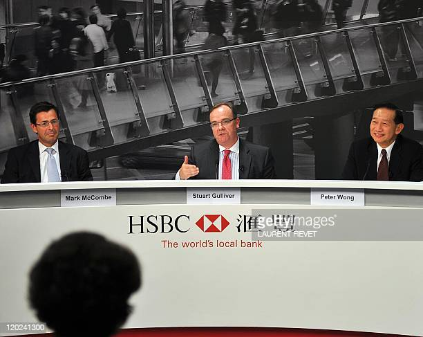 HSBC group chief executive Stuart Gulliver addresses a press conference while the company's AsiaPacific chief executive Peter Wong and chief...