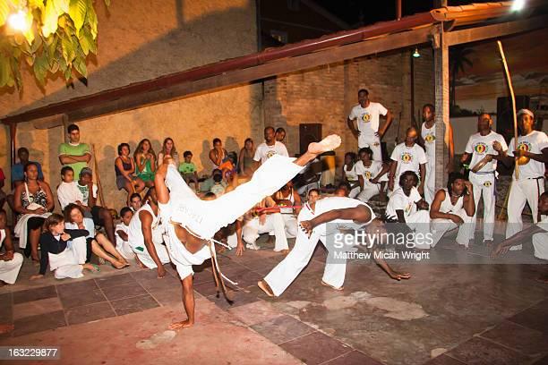 A group class practices Capoeira