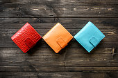 Group colorful Wallet of Leather skin on dark wooden background