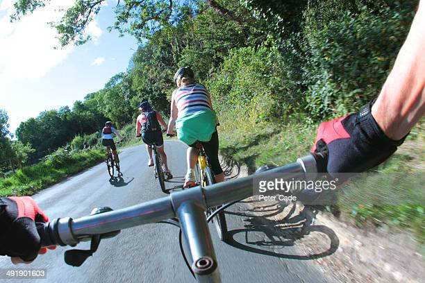 Group cycling on country road