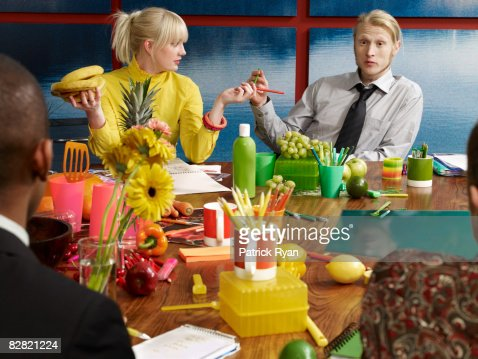 group discussing topic of fruit in the boardroom : Stock Photo