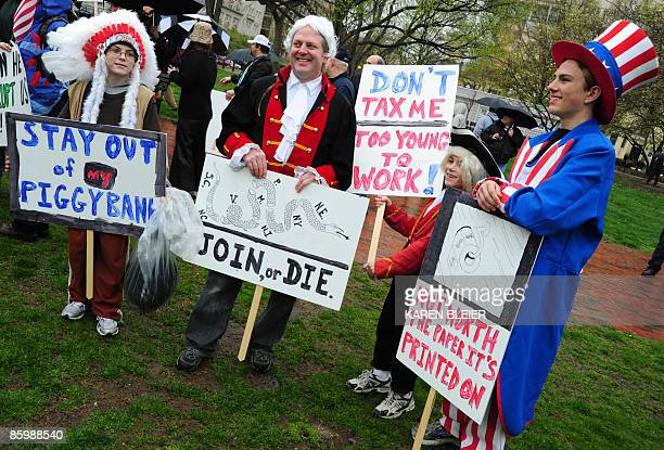 A group dressed in patriotic costumes protest during a 'tea party' demonstration in Lafayette Park across from the White House on April 15 2009 in...